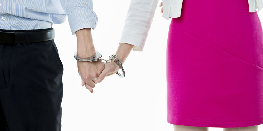 couple-in-handcuffs-holding-hands