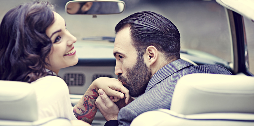 gentleman-kissing-ladys-hand-in-car
