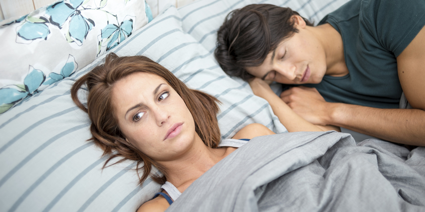 woman-not-happy-in-bed-with-man