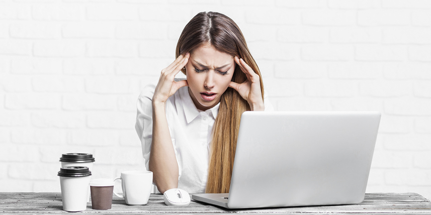 woman-stressed-beside-computer