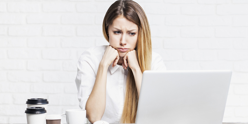 woman-worried-beside-computer
